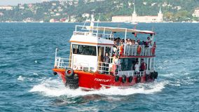 People crossing Bosphorus strait on a small passenger boat in Istanbul, Turkey royalty free stock images