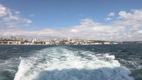 Timelapse video from a passenger ferry sailing in bosphorus overseeing istanbul cityscape and Besiktas District, Turkey stock footage