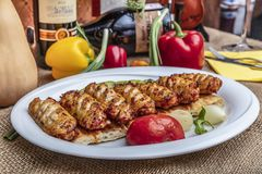 Istanbul, Turkey - October 8, 2018; Traditional Turkish Cuisine Bbq chicken wings served with alcoholic drinks. Restaurant in. Ocakbasi royalty free stock photos