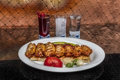 Istanbul, Turkey - October 8, 2018; Traditional Turkish Cuisine Bbq chicken wings served with alcoholic drinks. Restaurant in. Ocakbasi royalty free stock photo