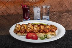 Istanbul, Turkey - October 8, 2018; Traditional Turkish Cuisine Bbq chicken wings served with alcoholic drinks. Restaurant in. Ocakbasi stock photos