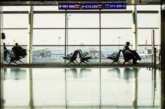 ISTANBUL, TURKEY - October, 2013: A view of the airport platform. And silhouettes of seated people on the window background Stock Photography