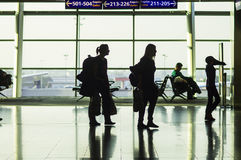 ISTANBUL, TURKEY - October, 2013: A view of the airport platform. And silhouettes of two girls with backpacks Stock Images