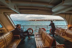 Passengers on a board of the ferry are shipped from the Asian part of Istanbul to the European. ISTANBUL, TURKEY: Passengers on a board of the ferry are shipped stock photos