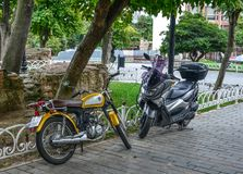 Scooters parked on the sidewalk of Istanbul royalty free stock photography