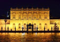 Istanbul, TURKEY September 19 - 2018. Dolmabahce palace seen from the water at night stock images