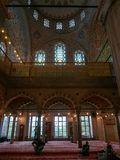 A group of men chit chat inside Sultanahmet mosque in Istanbul, Turkey. ISTANBUL, TURKEy-SEPTEMBER 24, 2016 : a group of men chit chat inside Sultanahmet mosque stock images