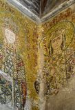 Istanbul, Hagia Sophia. Fragment of an ancient Byzantine mosaic depicting Empress Irina and Emperor Alexey Comnenos stock photography