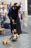 Istanbul, Turkey - September 07, 2014: Puppeteer Nehir Giritli working in the Kadikoy bazaar square Istanbul. Royalty Free Stock Photography