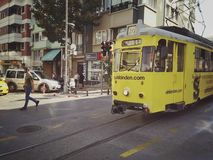 Istanbul, TURKEY - September 21 - 2018: Vintage yellow tram and pedestrians on Moda street in Kadikoy district royalty free stock images