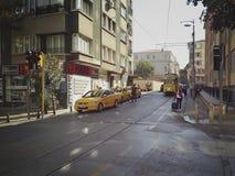 Istanbul, TURKEY - September 21 - 2018: Vintage yellow tram and pedestrians on Moda street in Kadikoy district royalty free stock photo