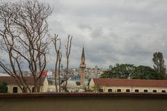 ISTANBUL, TURKEY: The view from Gulhane Park to the city: the minaret of the mosque, Galat tower, the house flag of Turkey.  royalty free stock image
