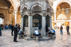 ISTANBUL , TURKEY. View Yeni Cami  New Mosque one of the most famous landmarks of Istanbul. Washing of the Feet. Royalty Free Stock Photo