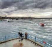 Istanbul turkish street life on a rainy autumn day. In november Royalty Free Stock Photo