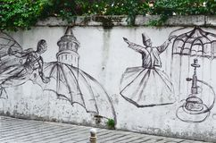 Istanbul, TURQUIE, le 25 septembre 2018 Mur de la rue art La danse des derviches et de l'homme de vol photographie stock libre de droits