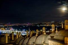 Istanbul under fullmoon. Istanbul city, bosphorus bridge, galata bridge and historical dome at same photo Royalty Free Stock Photography