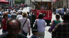 Istanbul. urban district of Beyoglu. Istiklal Street. Retro-tram. Famous istiklal street Istanbul Turkey, tram and crowded people at istiklal avenue stock video footage