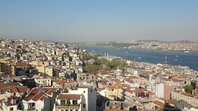 Istanbul. View on Istanbul city and Golden Horn Bay and Bosporus Strait separating two continents Europe and Asia with boats sailing on sea - Turkey stock video