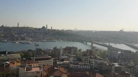 Istanbul. View on Istanbul city and Golden Horn Bay and Bosporus Strait separating two continents Europe and Asia with boats sailing on sea - Turkey stock footage