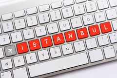 ISTANBUL writing on white keyboard with a aircraft sketch Royalty Free Stock Photo