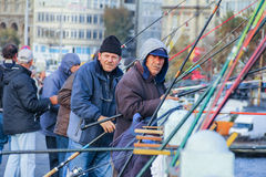 ISTANBUL Yulkey december 2014 People fish from the Galata bridge royalty free stock photo