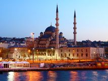 Istanbuls New Mosque at night. Istanbul with its New Mosque seen from the sea at night with traffic blurs Stock Images