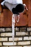 Istapp som hänger från vattenrör Royaltyfri Foto