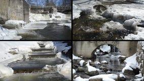 Istappar för is för flodvattenfallkaskad övervintrar den retro bron fryste arkivfilmer