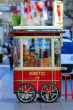 Istiklal avenue and the red cart selling pretzels - simit Stock Photo