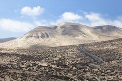 Istmo De La Pared, Fuerteventura. View from a hill at the famous Jandia coastline into Istmo De La Pared, Fuerteventura. This is a sand covered hill landscape Stock Image