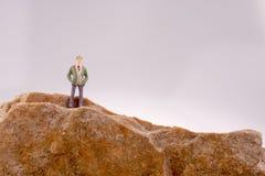 Istota ludzka na skale Zdjęcie Royalty Free