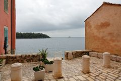 Istria. Adriatic sea at Istria peninsula view from opening between houses stock photo