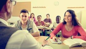Istruisca gli allievi alla lezione nella scuola Fotografia Stock