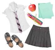 Istruisca gli elementi uniformi dell'abbigliamento della femmina isolati su fondo bianco Fotografia Stock