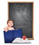Istruisca il bambino con il libro e la lavagna Immagini Stock Libere da Diritti
