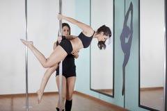 Istruttore e studente di forma fisica di Palo Fotografia Stock