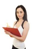 Istruttore femminile di forma fisica con carta Fotografia Stock