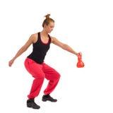 Istruttore femminile Exercise di forma fisica con Kettlebell Fotografie Stock Libere da Diritti
