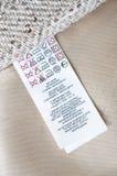 Istruzioni dell'etichetta dell'abbigliamento Fotografia Stock Libera da Diritti