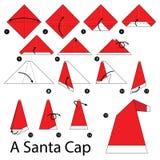 Istruzioni graduali come rendere ad origami Santa Cap Fotografia Stock