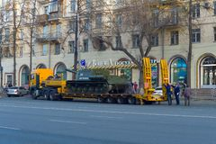 ISU-152 is loaded onto a trawl. Mechanics fix loading gangways. Chelyabinsk, Russia - May 2019: Transportation of heavy armored vehicles along Lenin Avenue. ISU royalty free stock image