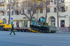 ISU-152 rises along the gangway to the trawl. Chelyabinsk, Russia - May 2019: Transportation of heavy armored vehicles along Lenin Avenue. ISU-152 rises along stock photography