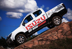 Isuzu branded vehicle displaying off-road capability Royalty Free Stock Photos