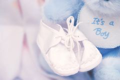It's a boy!. – Baby booties stock image