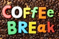 It's time for coffee break concept with colourful text on roasted coffee beans background stock photo