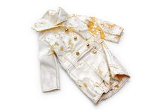 It's time to buy a new coat. Photo of a broken doll coat on a white background Royalty Free Stock Photo