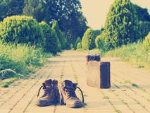 Boots, vintage suitcase, analog camera, yellow brick road. Nashville effect. It's time to wander the world and collect memories. Shabby ankle boots in a royalty free stock image