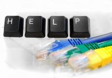 IT帮助与网络缆绳的四个键盘键在白色玻璃 库存图片
