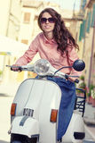 Itaian female sitting on scooter at old town's street. Royalty Free Stock Image