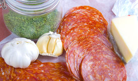 Itailan style lunch meats and ingredients royalty free stock images